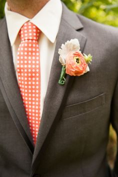 Orange ranunculus boutonniere  // photo by Jennifer Baumann Photography, http://theeverylastdetail.com/2013/10/11/rustic-coral-and-aqua-wedding/
