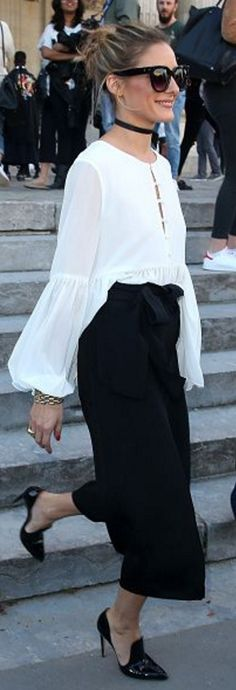 Who made  Olivia Palermo's black sunglasses, white button shirt, crop tie pants, and mule loafer pumps?