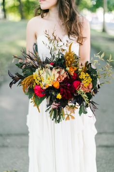 Fall Bridal Bouquet. Maroon, Orange, Yellow, Red, Green. Wedding. Natural. Earthy. Wild.   www.forestandfieldcreative.com www.anthemphotography.com