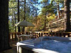 Happy Bear - Beautiful three level cabin with a hot tub. Has three bedrooms, two and a half baths and a wood burning fireplace.