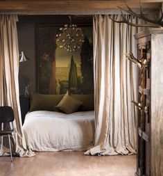 "Small Studio Apartment Big Ideas"" Use drapes to separate bed from rest of apartment. If I ever have that type of place! Love the art right by the bed."