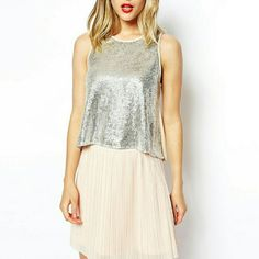 """NWOT silver sequin embellished swing top Silver sequined embellished swing top from ASOS. US women's size 6. Armpit to armpit measures 18"""" and top of shoulder to hem is 20"""".   Shirt is new without tags (NWOT) and has never been worn. Only tried on.  Smoke free home ASOS Tops"""