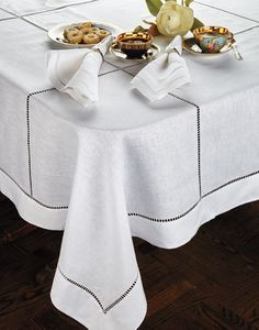 Handmade with pure Italian linen, reminiscent of grand dining in private chateaus, and a hemstitched pattern that feels both classically charming. White Dining Room Sets, Ikea Dining Room, Wooden Dining Chairs, Dinning Table, Glass Wood Coffee Table, Coffee Table Cloth, Table Top Covers, Embroidered Clothes, Table Toppers