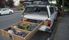 Guy turned his Tacoma into the ultimate weekend getaway vehicle featuring storage and a bed under the shell.