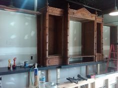 The bar being framed out.  We found this old armoire at Crumpton's auction, had it cut down in height and the sides built out to match!