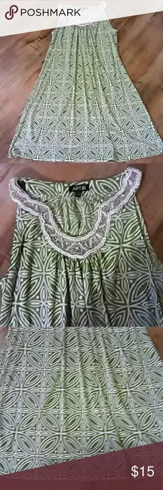 Apartment 9 dress size medium Beautiful dress with beaded embellishment . flares out it's green and white. It is absolutely gorgeous . it is 36 inches long. This dress is 96% polyester 4% spandex Apt. 9 Dresses Midi