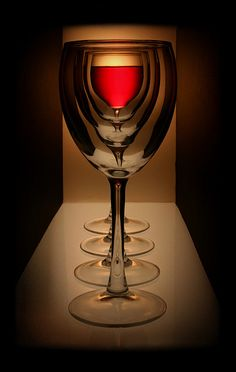 very cool picture of looking through glasses of wine