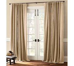 I love a drop cloth curtain.  Maybe a little too much because I have them all over in VT.  If this is a little boring for you just add some contrasting ribbon (just use fabric glue - no need to get all fancy).  I bet this would be an awesome project for Makenna.