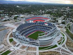 Invesco Field, home of the Denver Broncos, under construction in 2001, in front of the old Mile High Stadium
