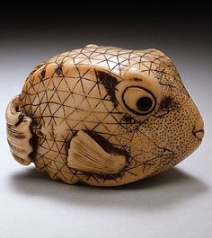 Blowfish, 18th century, Japan.  Artist Masaboa.  Netsuke with staining, sumi and inlays.  LACMA