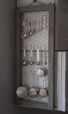 A simple wooden frame and some chicken wire make an adorable holder for measuring cups and spoons!