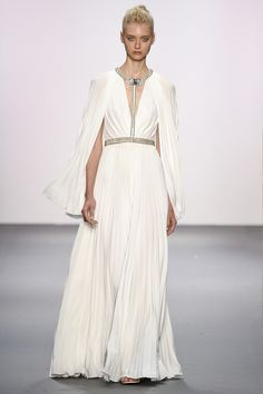 Jenny Packham Spring 2017 Ready-to-Wear: Angelic white gown with silver hardware and a caplet.