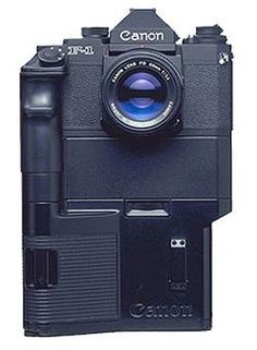 """What a Canon SLR Looked Like Back in 1984 Canon unveiled the High Speed Motor Drive Camera"""": a camera powered by huge battery packs that could chew through a roll of film in seconds. Photography Tools, Photography Camera, Photography Equipment, Pregnancy Photography, Street Photography, Landscape Photography, Portrait Photography, Fashion Photography, Wedding Photography"""