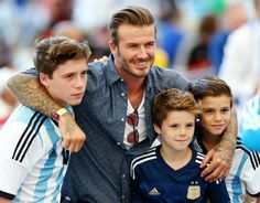 David Beckham's 15-year-old son Brooklyn is now a professional soccer player after signing a contract with Arsenal.