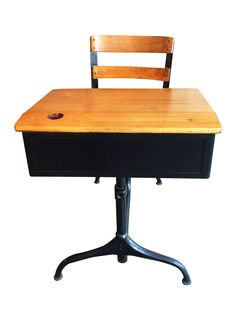 Circa 1930's, this child's school chair and desk has a built in pencil tray and a swivel seat for easy access. The desk top opens for storage. The metal is painted in a black patina giving way to its beautiful cabriolet legs. This is a wonderful functional piece, or avery cool display piece for the home!