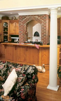 This #brick #range #hood is an inviting accent in the open #kitchen of the Herndon Home Design! http://www.dongardner.com/images.aspx?pid=246&fn=interiors\302kitch2.jpg