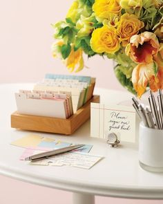 File this under A for adorable. Instead of a traditional guest book, use cards from an address file. Our set, by Lovely Design, contains handmade ones from vintage papers, so each is unique. Set cards on a table with a sign asking friends and family to jot down messages; once they've penned their notes, they can file their card alphabetically, leaving you to merely flip through all the warm wishes that range from A to Z.