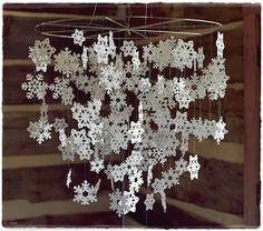 Sparkling snowflakes add winter wonder and ethereal style to kids' spaces. Paper snowflakes are laser-cut and finished with glitter. diameter, high A metal hoop with die-cut paper snowflakes sprinkled in glitter. Paper Snowflakes, Christmas Snowflakes, Winter Christmas, All Things Christmas, Christmas Holidays, Christmas Ornaments, Origami Christmas, Christmas Chandelier, Crochet Snowflakes