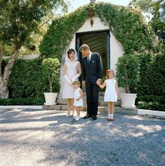 9350ac0c84a President Kennedy and Mrs. Kennedy pose with John Jr. and Caroline in front  of