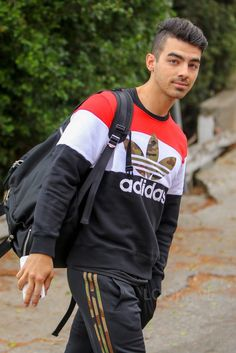 Joe Jonas wearing Adidas Block It Out Crew Sweatshirt, Adidas Camo Track Pants - Daily Fashion Joe Jonas, Adidas Camo, Try Guys, Crush Pics, Disney Boys, Disney Channel Stars, Jonas Brothers, Celebs, Celebrities