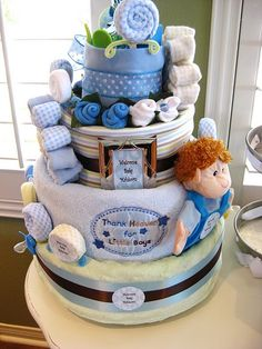 Diaper cake! Love it!! This whole thing is adorable except for that little boy doll thing.