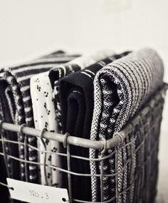 cute storage option for tea towels [via Likainen Parketti] Motifs Textiles, Metal Baskets, White Cottage, White Farmhouse, Smart Tiles, Black N White, Dark Grey, Kitchen Towels, Home Organization