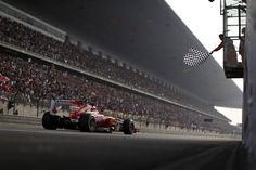 TIME - Hoch Zwei—Zuma Press April 14, 2013. Scuderia Ferrari takes the chequered flag winning the Formula One Chinese Grand Prix at the Shanghai International circuit, in Shanghai, east China.