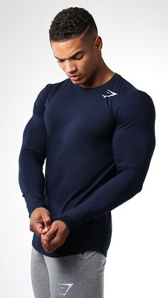 The Gymshark Long Sleeve T-shirt in Sapphire Blue is part of our essential Ark range. A fitted long sleeve t-shirt with no nonsense design and a simplified fit for a refined look.