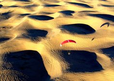 Gliding over sand dunes. Anyone know where this shot was taken? (from onebigphoto.com)
