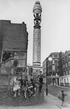 Youngsters play on the corner of Great Titchfield Street and Clipstone Street in front of the Post Office Tower, later the BT Tower, in 1965.