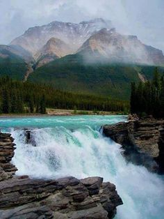 Athabasca Falls is a waterfall in Jasper National Park on the upper Athabasca River, approximately 30 kilometres south of the townsite of Jasper, Alberta, Canada, and just west of the Icefields Parkway Places Around The World, Oh The Places You'll Go, Places To Travel, Places To Visit, Around The Worlds, Travel Destinations, Beautiful Waterfalls, Beautiful Landscapes, Beautiful World