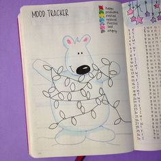 Sharing with you how I've set up my bullet journal for December and which spreads I've added. This is my Mood Tracker.  Click on the picture to get access to the FREE printable I've created for you of this page.
