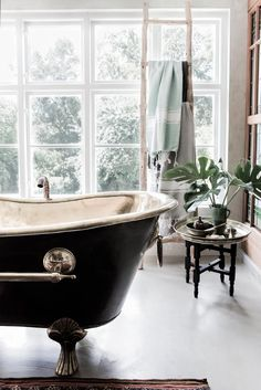 stunning black claw foot bathtub with silver interior + details | home decor + decorating ideas for the bathroom