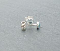 Handmade stud earrings in sterling silver and sky blue topaz