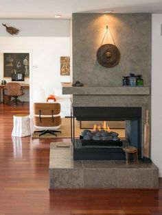 Room division is a breeze with two-sided fireplace – Open Fireplace Designs to Warm Your Home Build A Fireplace, Open Fireplace, Fireplace Remodel, Living Room With Fireplace, Fireplace Design, Fireplace Mantels, Fireplace Ideas, Rock Fireplaces, Living Rooms