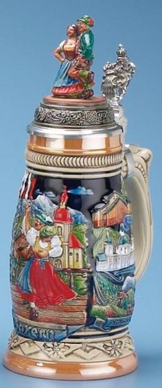 Alpenland Dancers Stein (Authentic German Beer Stein) - The raised relief, hand painted decoration features a Bavarian couple dancing with an Alpine scene behind them. | via 1001beersteins.com | #Art #LimitedEdition #BeerSteins #Steins |