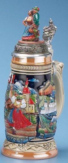 Alpenland Dancers Stein (Authentic German Beer Stein) - The raised relief, hand painted decoration features a Bavarian couple dancing with an Alpine scene behind them. | via 1001beersteins.com | #Art #LimitedEdition #BeerSteins #Steins |