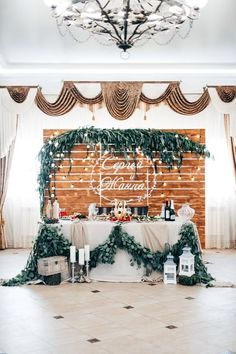 rustic wooden pallet wedding backdrop and sweetheart table with greenery garland #weddingideas #countryweddings #rusticweddings #weddingdecor #weddingbackdrops