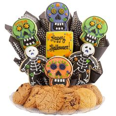 Sugar skulls and skeleton treats make up this delectable Halloween cookie boutray. These Halloween cookies make a great addition to a party or to send as a gift. #picsandpalettes