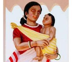 En la India, Virgen María bajo la apariencia de una mujer aborigen que llevaba un sari tradicional con un borde rojo, y al niño Jesús lo lleva en la cadera a la manera local, envuelto en un trozo de tela.
