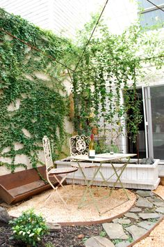 cool outdoor room. Love the vining plants as walls and ceiling