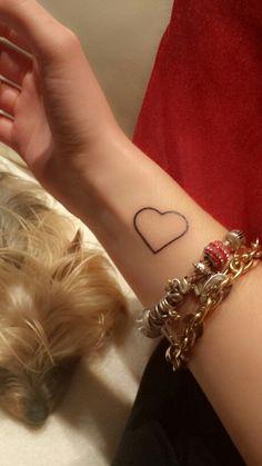 Small tattoo heart on wrist
