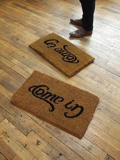 come in - go away doormat: http://www.suck.uk.com/product.php?rangeID=66