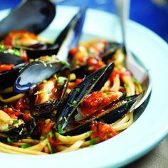 This combination of mussels with plenty of garlic, parsley, saffron and white wine was inspired by the Venetian soup zuppa de peoci, which is usually ladled over sliced crusty bread. Here we serve it over pasta. For a more elegant presentation you can remove the mussels from their shells before serving…but then again, who wants to be elegant? Enjoy!
