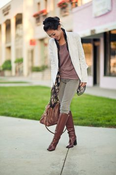 We adore her Alexander McQueen Scarf paired with riding boots and colored jeggings!  Check out our version of this style under our Denim board (Paige Verdugo Jeggings in Olive)!