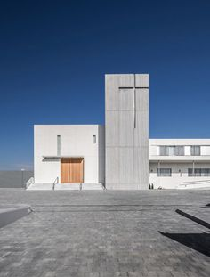 Hernández Arquitectos' Minimal White Monastery Features A Concrete-clad Bell Tower - http://decor10blog.com/decorating-ideas/hernndez-arquitectos-minimal-white-monastery-features-a-concrete-clad-bell-tower.html