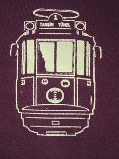 This is a close-up of a Taskim tram, that the graphic designer of JessE Designs created, for a custom polo for Pera Soho restaurant in NYC.  The Taskim tram is featured as the center piece in a mural in the main dining room of the restaurant.