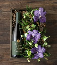 Cheers to new beginnings and the promise of a new year with a whimsical display of red wine and fresh flowers by Winston Flowers. Diy Flower Boxes, Flower Box Gift, Flowers Wine, Pretty Flowers, Fresh Flowers, Wine Gift Boxes, Wine Gifts, Floral Centerpieces, Floral Arrangements