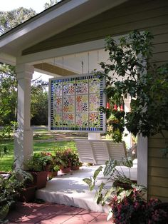 The 12-pane floral window was a DIY project using tile nippers, lots of caulk, glass pieces and glass globs for the flower centers. It turned out to be a wonderful art experiment.