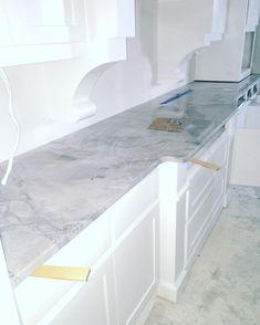 Super White Quartzite Countertop by @mytexashouse